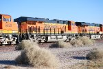 BNSF 7548 leads two ES44C4's (BNSF 6627 & BNSF 6620) into the BNSF Barstow yard pulling a eastbound Z.